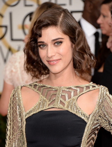 Masters of Sex star, Lizzy Caplan arrives on the 71st Annual Golden Globe Awards' red carpet. (photo: coutesy of Pivotal PR)