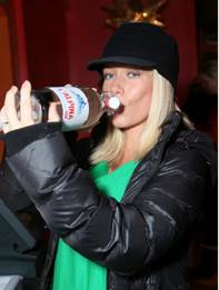 Altitude or morning sickness? Kendra Wilkinson knows what it means about keeping hydrated in Park City Utah's high altitude as she chugged L'Alpina water. The pregnant mom hydrated while hanging out at the TR Suites in Park City, Friday, Jan. 17, 2014, in Park City, Utah. (Photo Credit: Alexandra Wyman/Invision for Talent Resources/AP Images)
