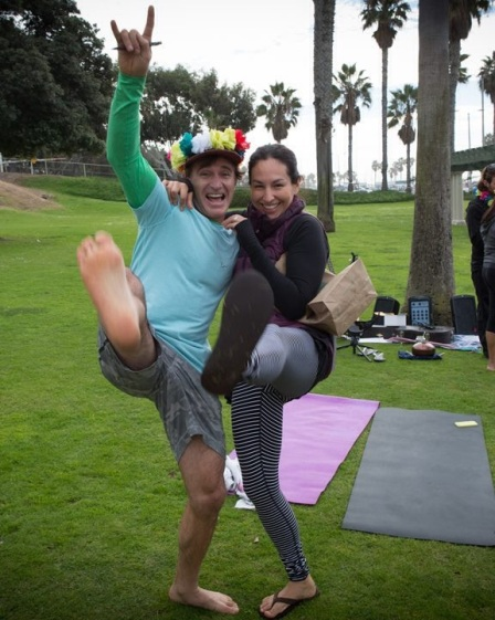 Blisologist, Eoin Finn, and photographer Patricia Pena kick up their yogi heals after a pre-Wonderlust Festival yoga session near Santa Monica beach (photo: courtesy of Lululemon and Patricia Pena Photography)