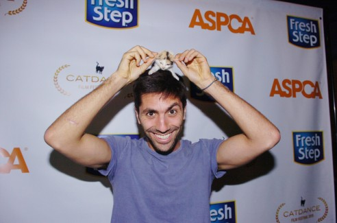 MTV's Catfish Nev Schulman star cuddling with a Fresh Step & Catdance kitten to raise money the ASPCA! (photo: Milla Cochran)