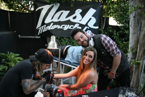 Bravolebrity Scheana Marie getting a musical note tattoo by Adam Daniels of Nash Motorcycle Co. at the Movie Awards Eco Lounge (photo: