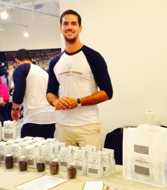 Grounds & Hounds founder, Jordan Karcher, brewing beans to help hounds in need at BeautyCon LA 2014 (photo credit: Alexa Wyman)