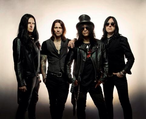 Slash and his band, The Conspirators (photo credit: Travis Shinn)