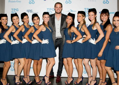 "Brian Kelly, ""The Points Guy,"" with his crew of hostesses dressed as flight attendants for his ""TBG to Go"" App launch party at the W Loft in Hollywood"