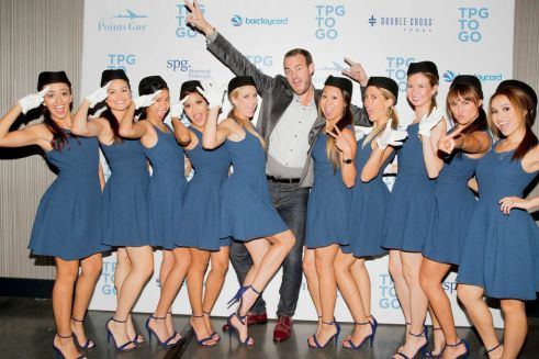 "Brian Kelly, ""The Points Guy,"" with his crew of hostesses dressed as flight attendants for his ""TBG to Go"" App launch party at the W Loft in Hollywood (photo: courtesy of The Points Guy)"