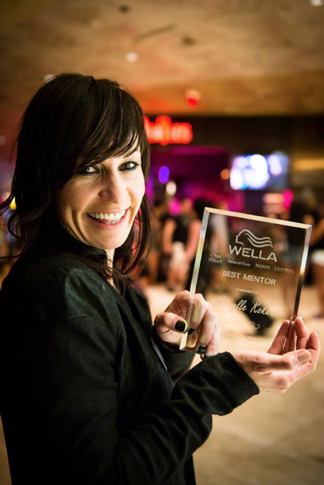"""Marylle Koken, owner of The Harlot Salon, with her Wella """"Best Mentor"""" award (photo: courtesy of The Harlot Salon)"""