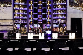 Lit up bar of STK LA (photo: courtesy of The ONE Group)