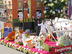 Chris Salgardo, President, Kiehl's SINCE 1851, center, rides on the Kiehl's SINCE 1851 float, winner of the Extraordinaire Trophy, during the 126th Rose Parade on Thursday, Jan. 31, 2014, in Pasadena, Calif. (Photo by Todd Williamson/Invision for Kiehl's SINCE 1851/AP Images)
