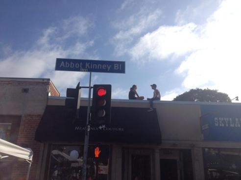 Sharing a moment. Hip Abbott Kinney Blvd in Venice, California