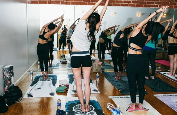 Ladies dawning La Vie Boheme Yoga mats getting a tranquil work out at Modo Yoga LA with Joe Komar (photo credit: Jennifer Castro Photography)