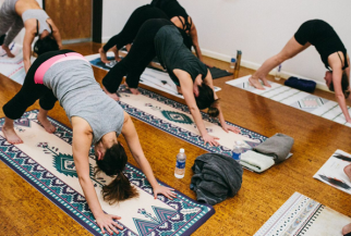 Bowing to La Vie Boheme Yoga mats in Downward Dogs at Modo Yoga LA (photo credit: Jennifer Castro Photography)