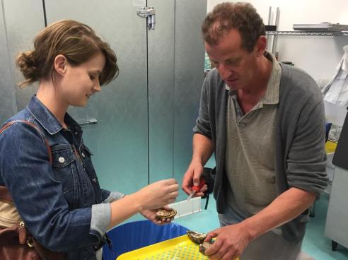 Jolly proprietor Mark Reynolds shows El Segundo resident Cecilia the right way to shuck.