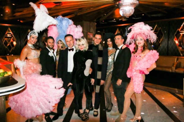 The h.wood Group's Brian Toll, Markus Molinari & John Terzian with David Arquette, Bootsy Bellows girl, and burlesque dancers. (Photo credit: Chelsea Lauren/ Getty Images)