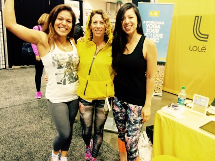 Lolë ambassador, Faten El Harake, LaLaScoop co-founder and Andiamo Body owner/trainer, Rochelle Robinson, and Lolë Community Coordinator, Jennifer Noriega, at Lolë Women Booth at 2015 IDEA World Fitness Conference in Los Angeles