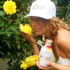 Rochelle Robinson, co-founder of LaLaScoop and owner/trainer at Andiamo Body enjoying roses and drinking H2rOse (photo credit: Sydney Ramone Stokes)