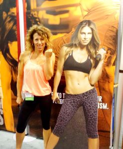 Rochelle Robinson (LaLaScoop and Andiamo Body) striking a pose wiht cardboard cut-out of Jillian Michaels at 2014 Idea World Fitness Convention, promoting Body Shred