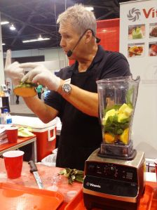 Spinach Man (Ingo) talking about the most nutitious part of a pinapple before he places it into the incredible Vitamix blender at 2014 Idea World Fitness Convention (photo credit: Rochelle Robinson)