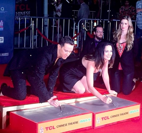 Jeremy Scott and Katie Perry cemented in friendship outside the historic TLC Chinese Theatre. Jeremy Scott is the only fashion designer to have his hand prints in the Hollywood Walk of Fame. (Photo credit: Jasmin Rosemberg)