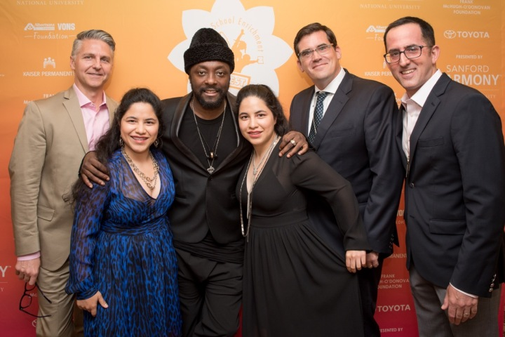 will.i.am with LA's BEST representatives and America & Penelope Lopez, the CyberCode Twins and winners of the Distinguished Alumni Award. (Photo credit: Ben Gibbs)